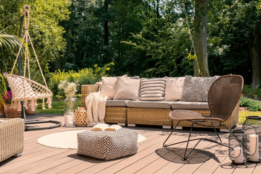 Relaxing composite deck in a Derby backyard with a lounge chair a couch and a hammock chair